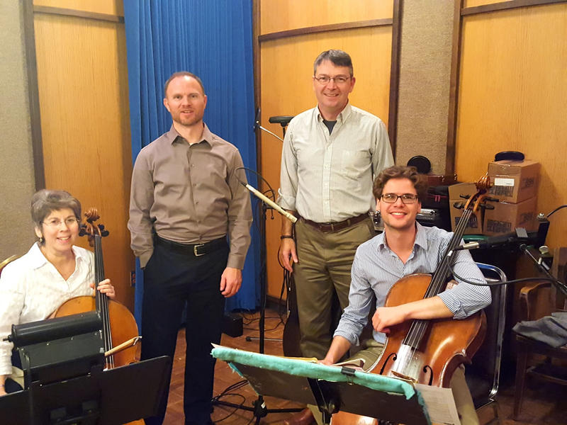 Live studio guests Fern Glass Boyd, professor of cello at UM; Christopher Hahn, professor of piano at UM; and Theodore Buchholz, cello professor and head of strings at the University of Arizona pose for a picture with MTPR'S Michael Marsolek.