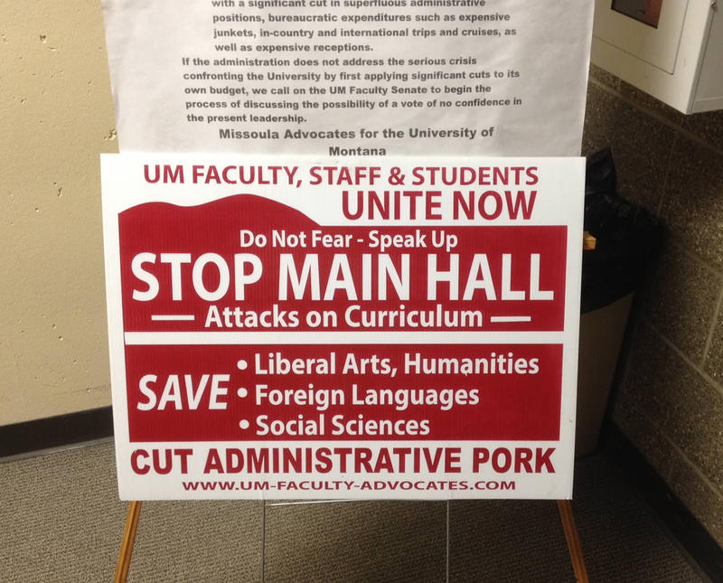 A sign seen at Tuesday's meeting for faculty feedback on UM President Engstrom's plan to cut 201 jobs because of declining enrollment.