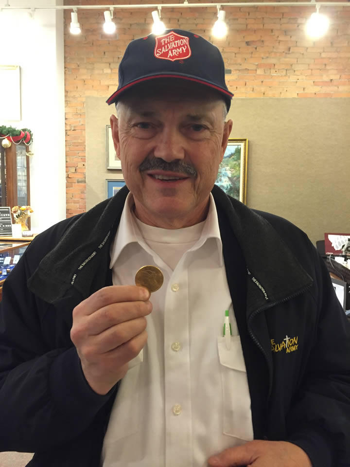 Salvation Army Major Steve Svenson holds a Liberty Head Double Eagle donated to the Salvation Army in Columbia Falls.