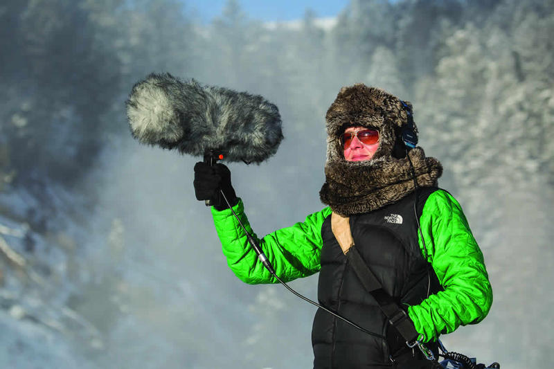 Jennifer Jerrett recording sound for Yellowstone Collections at Mammoth Terraces on November 15, 2014.