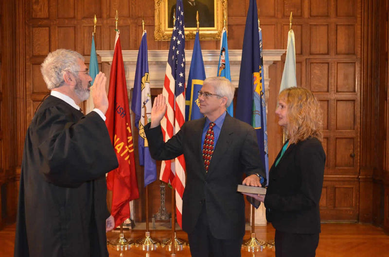 Chief Justice Mike McGrath, left, swears in Mike Cooney as Montana's 32nd lieutenant governor with Cooney's wife, Helena District Judge DeeAnn Cooney, at his side.