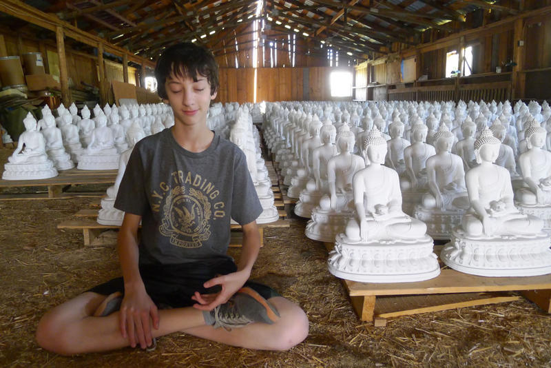 Michael, now a senior in high school, imitating a meditation pose at the Garden of One Thousand Buddhas.