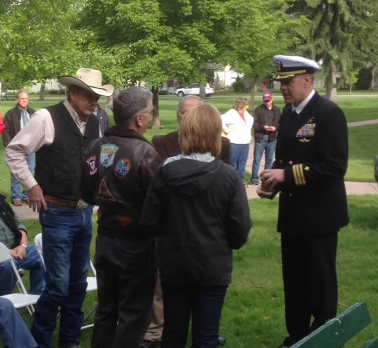 Rep. Ryan Zinke (right), a U.S. Navy SEAL veteran, handed out the lapel pins to local veterans who served on active duty during the Vietnam War years.