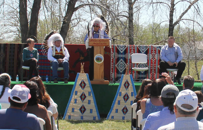 Chief Earl Old Person speaks before a crowd at All Chief's Park in Browning, on May 3. Secretary of the Interior Sally Jewell also spoke at the event, which signified the Blackfeet Tribe's first step in participating in the federal Land Buy-Back program.
