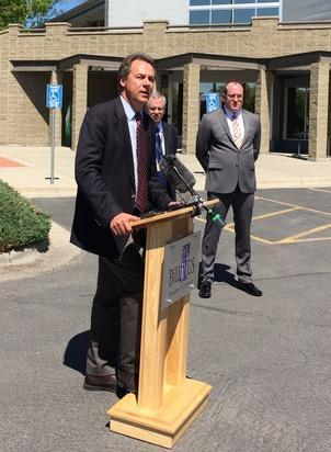 Governor Steve Bullock, D-MT, announcing Billings is the first area in the country to be re-designated as meeting federal air quality standards for SO2. Behind Bullock is John Felton of Riverstone Health and Jeff Walters of the Billings Chamber of Commerc