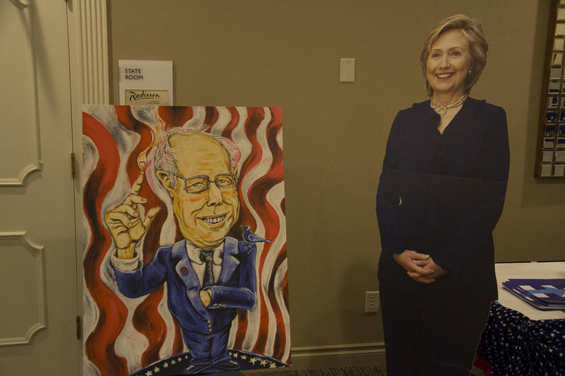 When the convention started on Friday, a cardboard cutout of Hillary Clinton in a suit stood next to the event room doors. By Saturday afternoon, a slightly abstract portrait of Bernie Sanders was placed next to her.