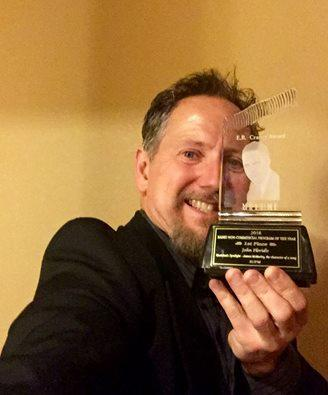 "John Floridis, host of ""Musician's Spotlight"" holds his second consecutive EB award for Non-Commercial Radio Program of the Year from the Montana Broadcasters Association."