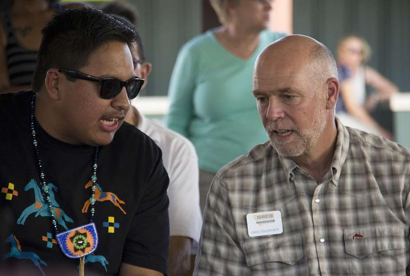 Vance Home Gun and Greg Gianforte talk during the Arlee powwow.