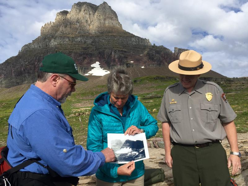 Dan Fagre, a climate change researcher with the U.S. Geological Survey, shows US Interior Secretary Sally Jewell a photo of Glacier in 1914