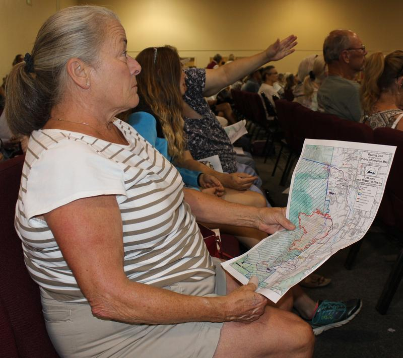 A resident of the Bitterroot valley references an evacuation map of the Roaring Lion fire during a community meeting in Hamilton August 4, 2016.