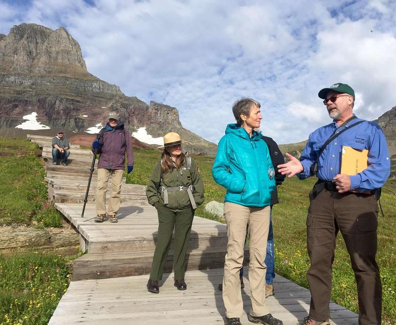 Secretary of Interior Sally Jewell talks with Dan Fagre of the USGS about climate change in Glacier National Park during the centennial celebration of the National Park Service, August 25, 2016.