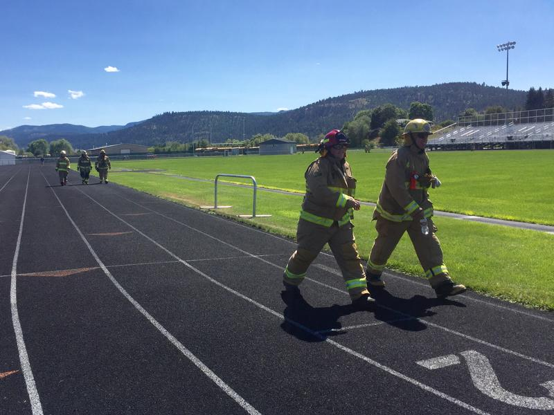 Volunteer firefighters from the Flathead Valley walked a mile to raise money for reparis and equpment for the Smith Valley Fire Department's Foys Lake staion, which was damaged by arson fire on July 3.