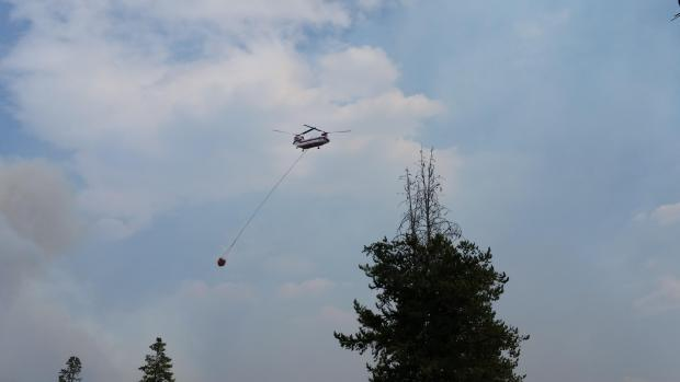 A Chinook helicopter brings water to the northwest portion of the Maple Fire over the weekend.