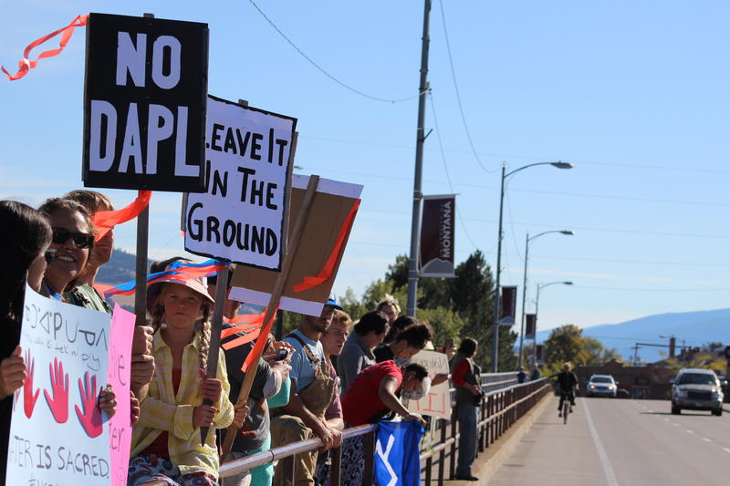 "Self-titled ""Protectors"" gathered on the Higgins Street Bridge on September 13, 2016 to protest the Dakota Access Pipeline. Other rallies happened in Whitefish, Poplar, and Lame Deer."