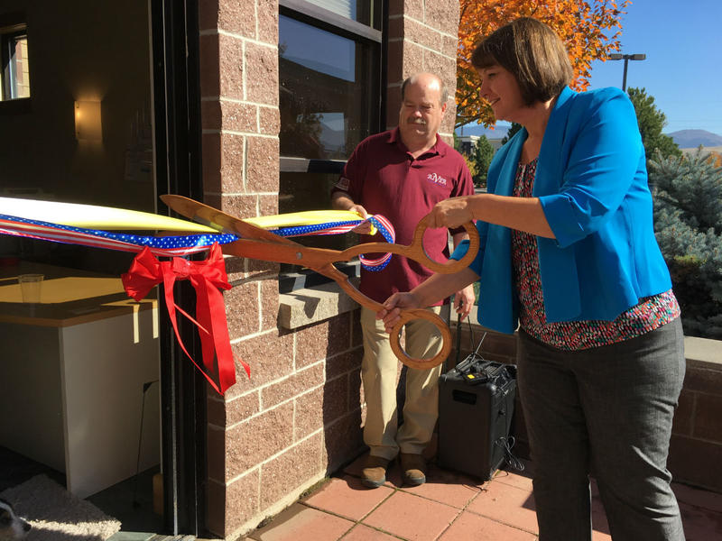 Denise Juneau, right, cuts the ribbon Ed Lesofski holds up at the grand opening ceremony for the Rural Institute for Veterans Education and Research in Missoula Thursday, Sept. 29. RIVER is considered a first-of-its kind program for veterans.