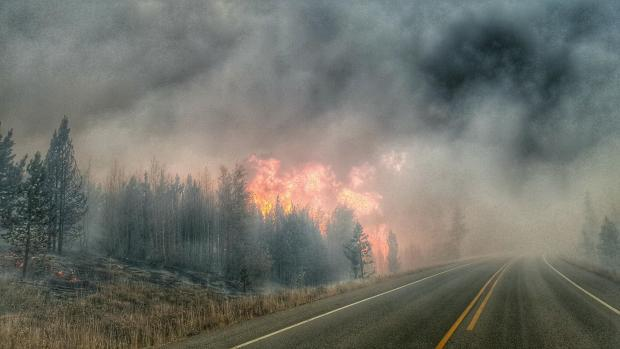 Smoke and flames from the Berry Fire hit Highway 89 on September 11, 2016