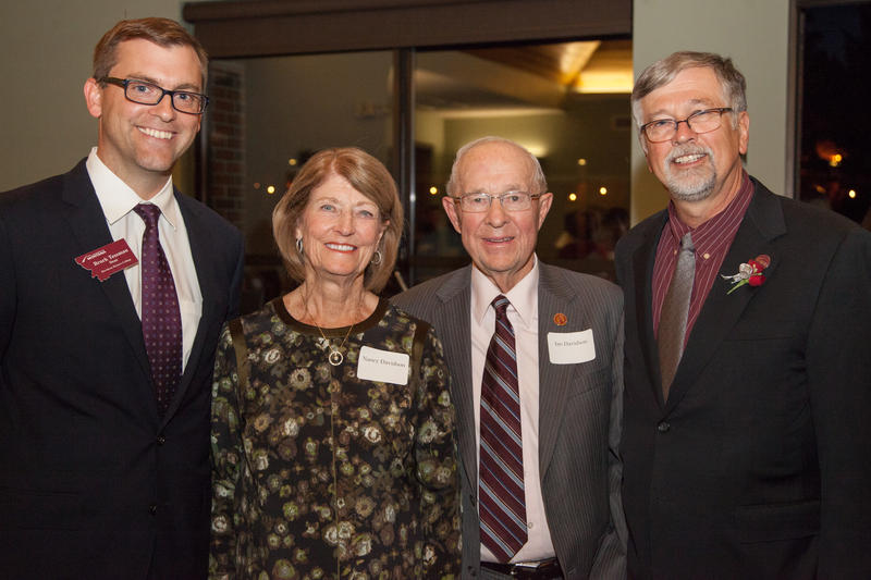 Davidson Honors College Dean Brock Tessman, left, with Nancy and Ian Davidson, and UM President Royce Engstrom this weekend