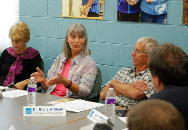 Barbara Dryden, center, and Richard Blank, to her left, tell Governor Steve Bullock about the challenges family caregivers face Monday at Missoula Aging Services.