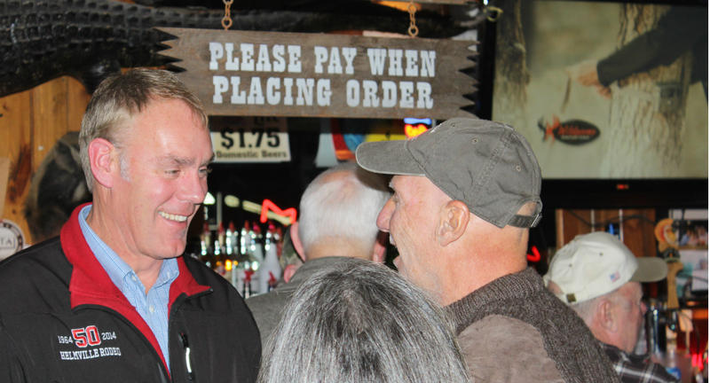 Republican Rep. Ryan Zinke, left, campaigning at the Blue Moon Nite Club in Columbia Falls Thursday.