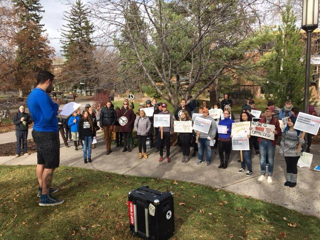 Antonio Moresette addresses a crowd of demonstrators at the University of Montana who want UM officials to limit their cooperation with federal immigration authorities, Nov 16, 2016.