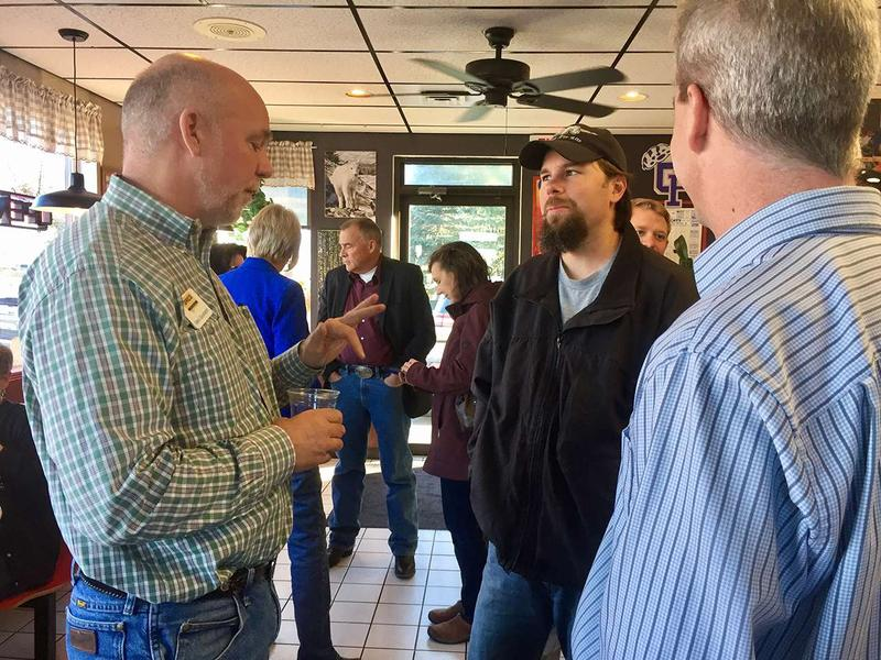 Gianforte talks with Brian Friess of Kalispell during a campaign stop in Columbia Falls, Montana Nov. 4, 2016.