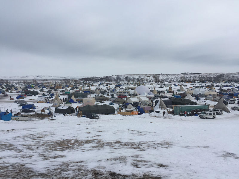 "Oceti Sakowin camp, as seen from ""Media Hill,"" where MTPR's Nicky Ouelette spoke to News Director Eric Whitney earlier today."