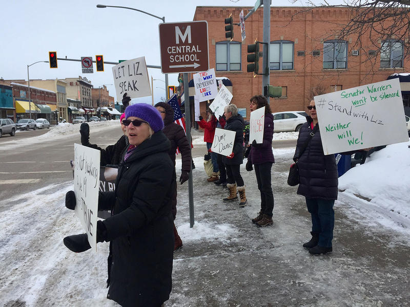 About 25 members of the activist group Big Sky Rising protested outside Sen. Daines' Kalispell office Wednesday, Feb. 08 over the senator's role in silencing Sen. Elizabeth Warren.