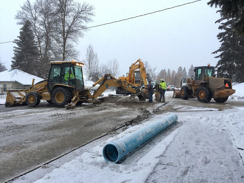 Crews in Whitefish dig at the site where the city water main burst Monday morning on Baker Avenue.