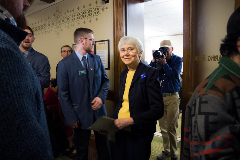 Carole Mackin, a taxpayer from Helena, is escorted out of a hearing room at the Montana Capitol by a sergeant-at-arms Thursday, March 23 after she refused to stop her testimony in support of Senate Bill 305, which would allow mail ballot elections.