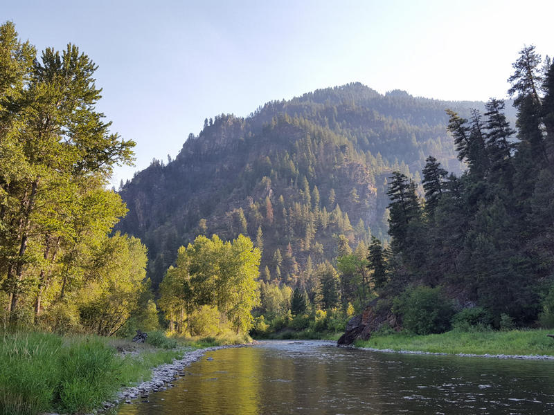 The sun setting on Rock Creek in western Montana.