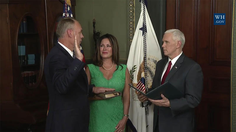 Vice President Mike Pence swears in Ryan Zinke as secretary of the interior during a March 1, 2017 ceremony at the White House, with Zinke's wife Lola looking on.