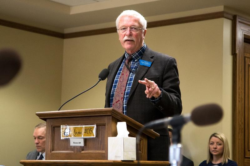 Sen. Dick Barrett, D-Missoula, says during testimony Monday that his bill would clarify the intent of past legislation to include online travel companies in the state's bed tax.
