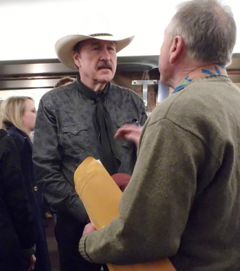 Rob Quist talks with supporters during a campaign stop in Great Falls, April 11, 2017.