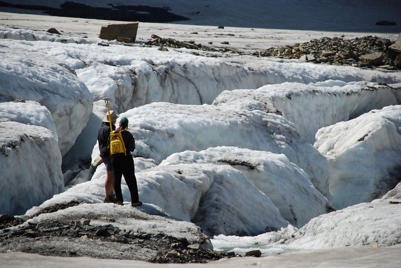 These scientists are using GPS units to record precise locations of the edges of Grinnell Glacier.