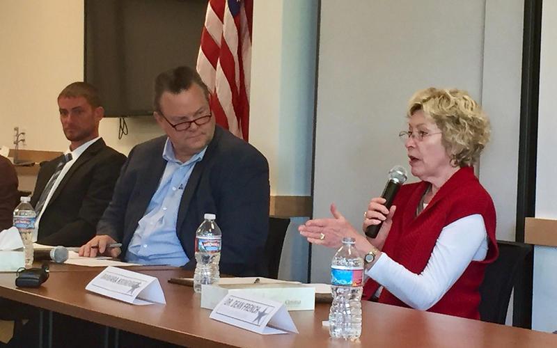 Senator Jon Tester listens to Barb Korenberg from Missoula Skin Care Center at a veterans health care forum in Missoula Wednesday, May 31, 2017.