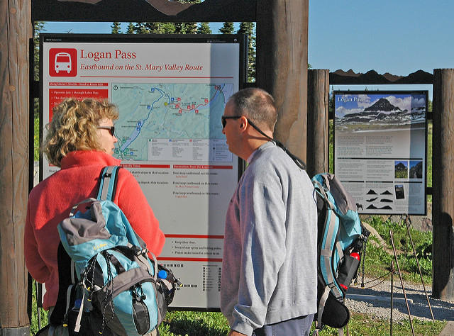 Glacier National Park visitors wait for the shuttle bus.