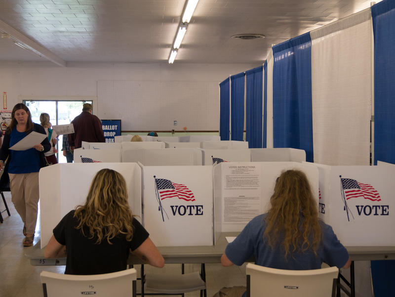 Voters cast ballots at the Missoula County Fairgrounds, May 25, 2017.