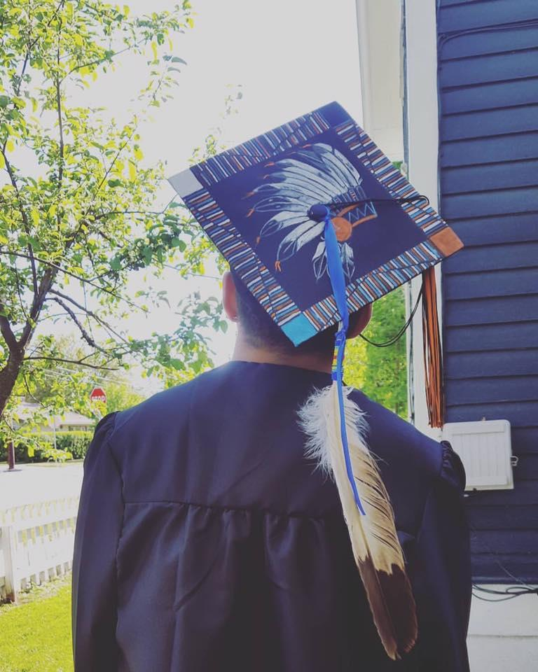 Zephry Holloway's grandmother painted the motarboard for his high school graduation ceremony. The school said he couldn't wear it.