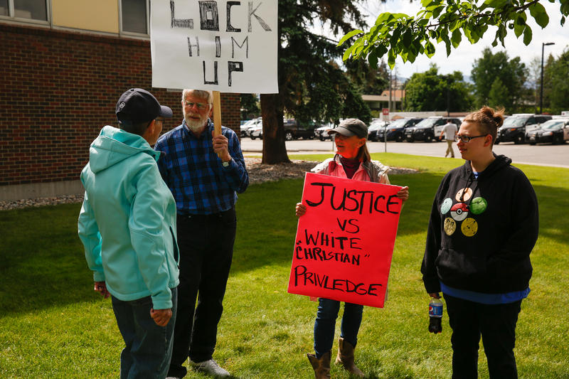 Several protesters gather outside the Gallatin County Justice Court during Gianforte's court appearance.