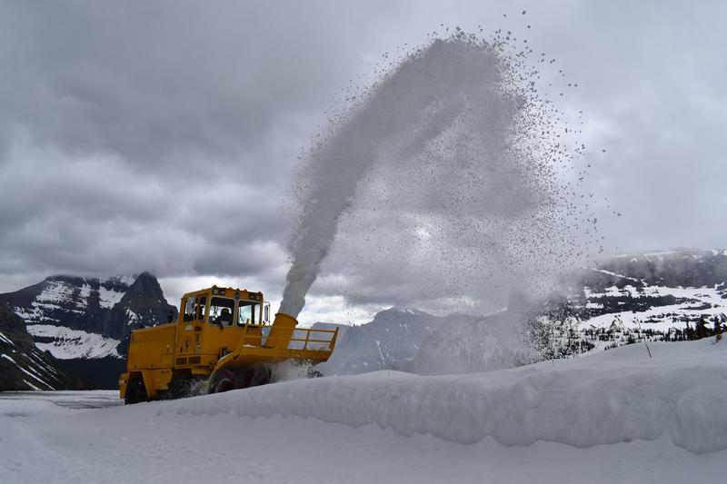 A snow blower clears off the final snow drifts on the Going to the Sun Road in Glacier National Park, MT.