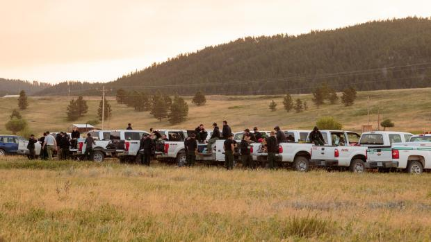 Some of the crews fighting the July fire on Friday morning