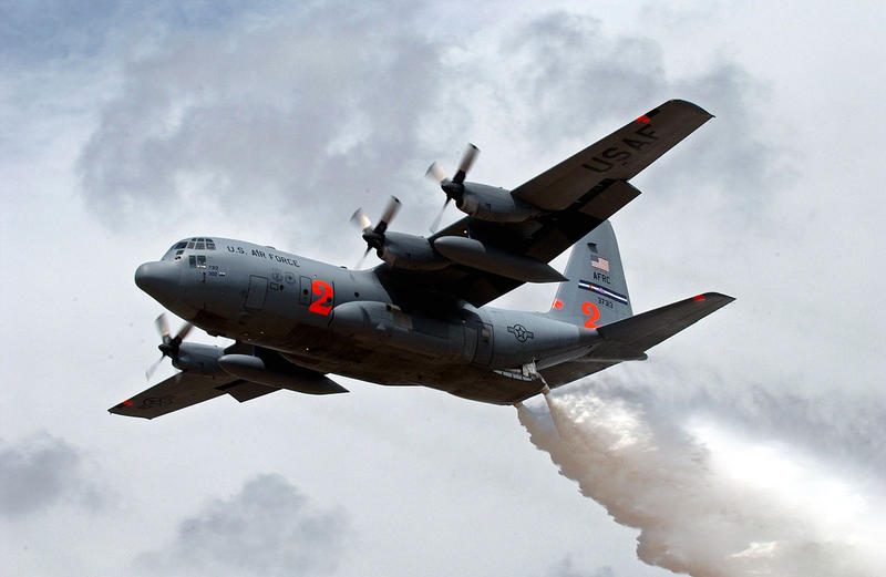 A MAFFS-equipped C-130 Hercules from the 302nd Airlift Wing makes a water drop over New Mexico during a training exercise, May 2007.