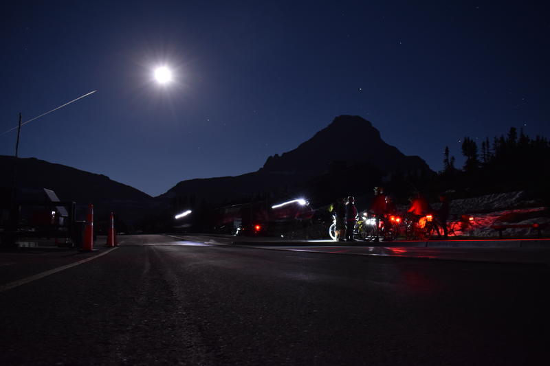 Cyclists admire the view atop Going to the Sun Road under a full moon Saturday night