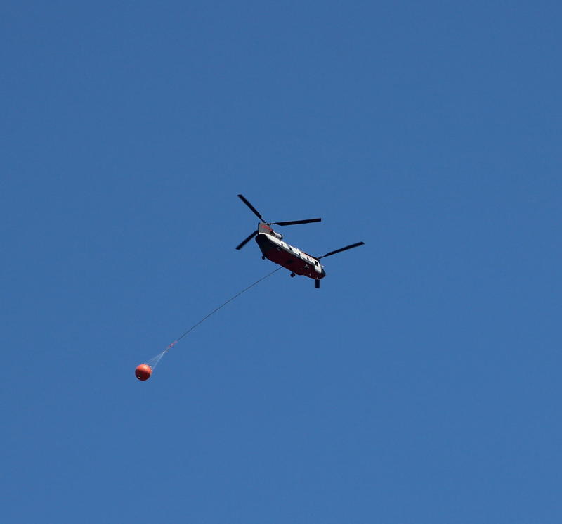 A firefighting helicopter flies over Missoula recently