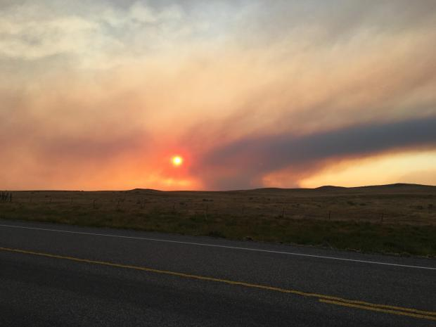 Sand Springs on Highway 200 July 21, looking west-northwest through smoke from the Lodgepole Complex.