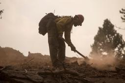 A firefighter on the Rice Ridge Fire