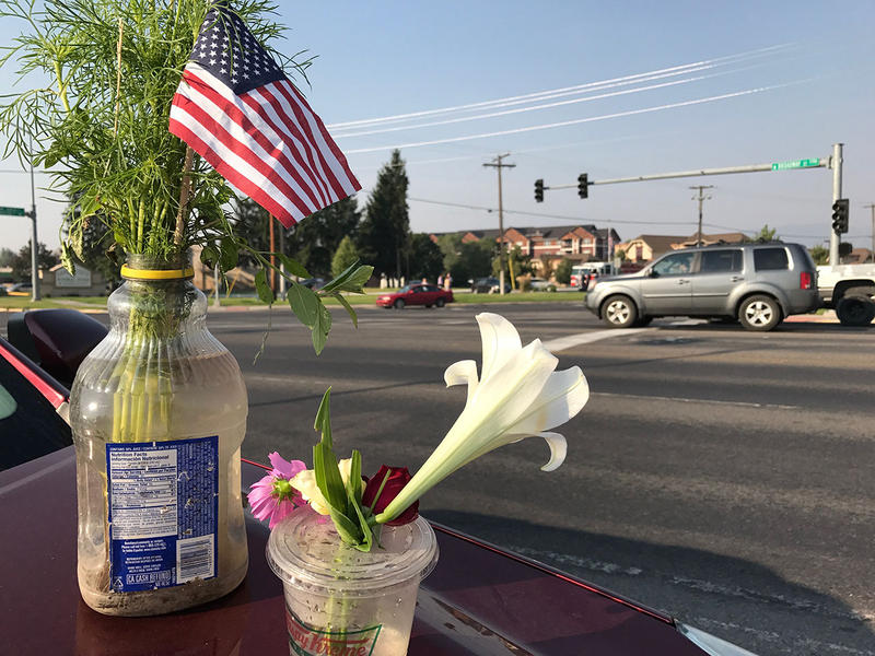 Kate Gemar brought flowers to honor the Brent Witham, the California fireighter who died in western Montana last week. Firefighters from across the country this morning escorted Witham's body from the Garden City Funeral Home to the Missoula airport.
