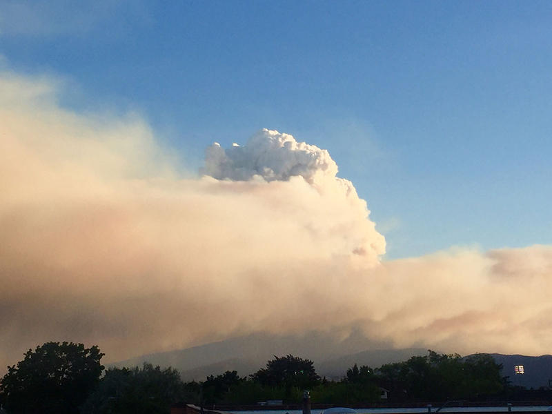 The Lolo Peak Fire sends a large plume of smoke into the air, visible from Missoula on the evening of Wednesday, August 16, 2017.