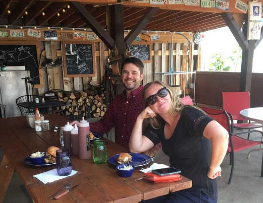 Greater Yellowstone Coalition's Scott Christensen and Liz Purdy eating lunch at Follow Yer Nose BBQ in Emigrant on their way out to Jardine, MT for a conservation celebration.