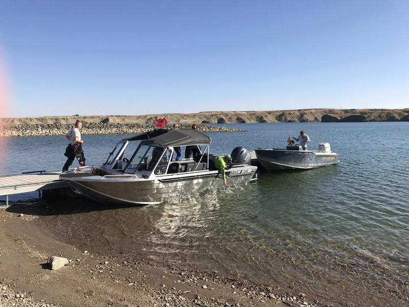 Divers with the U.S. Fish & Wildlife Service and Montana FWP prepare to dive at Tiber Dam to look for adult zebra and/or quagga mussels, August 7, 2017.